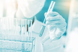 scientist hand holding laboratory test tube science laboratory research and development concept