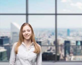 Young Beautiful Business Lady Is Smiling In The Panoramic Glass